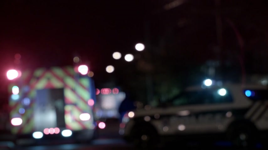 ambulância : Ambulance, Cops and Firetrucks Blurry Lights Background at Night during a House Fire Stock Footage
