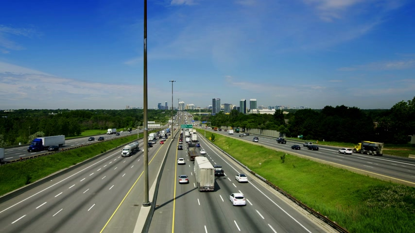 busiest : Wide angle View of Kings Highway 401 near Toronto in Ontario Canada. The part of Highway 401 that passes through Toronto is the busiest highway in the world.