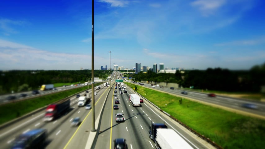 busiest : Tilt-Shift of Kings Highway 401 near Toronto in Ontario Canada. The part of Highway 401 that passes through Toronto is the busiest highway in the world. Stock Footage