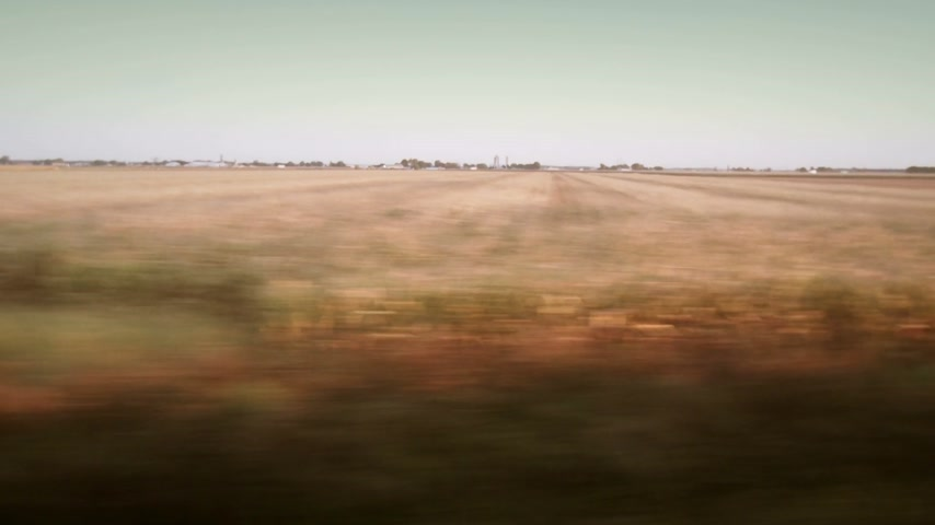 beautiful view : Blurry Fields View from a Fast Train Window filmed at 180 degrees Stock Footage