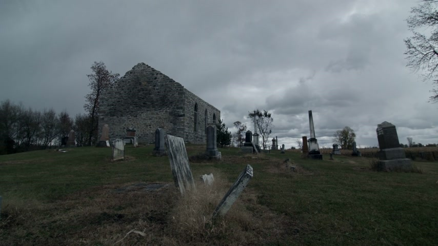 temor : Time Lapse of a Very Dark and Sullen Halloween kind of Footage of Abandoned Church and Cemetery on a Moody Cloudy Day Stock Footage