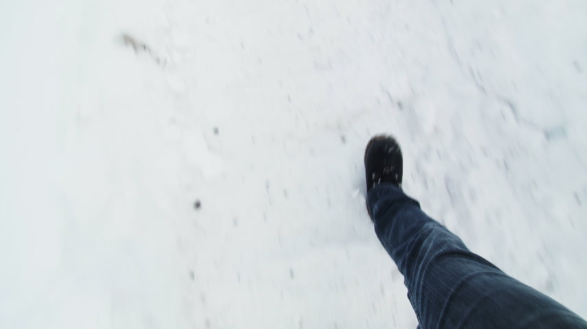 tramp : POV of Man Walking over path in the Snow