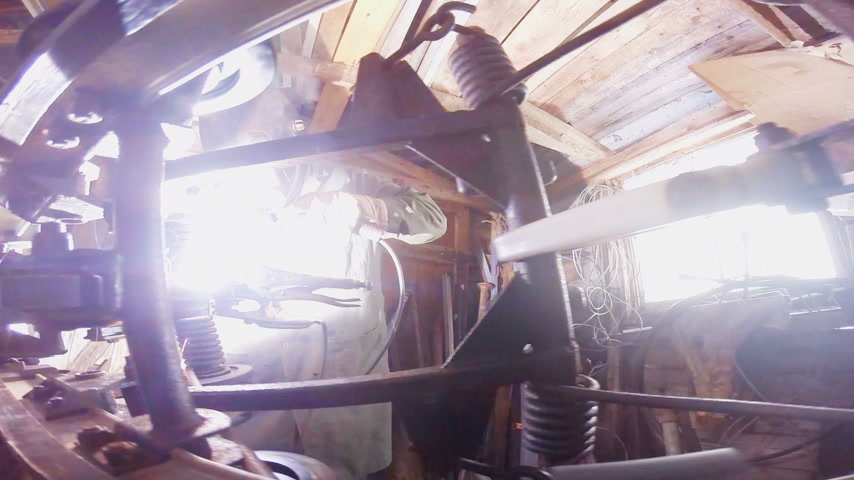 Man Welding a Snowmobile Frame at Home in a Workshop Stock Footage