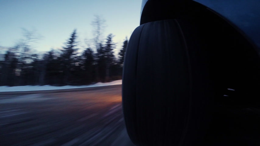 ralli : Closeup of a Rally Car Wheel Driving Off Road during Winter Sunset