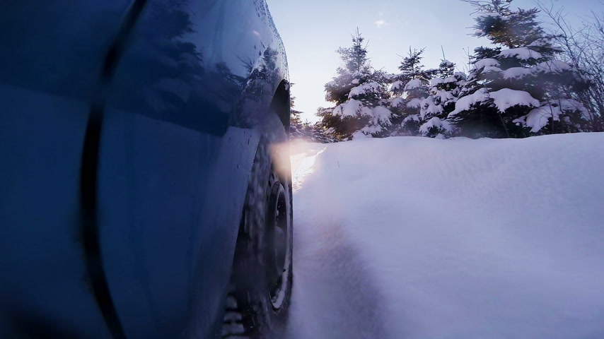 ралли : Closeup of a Rally Car Wheel Driving Off Road during Winter Sunset
