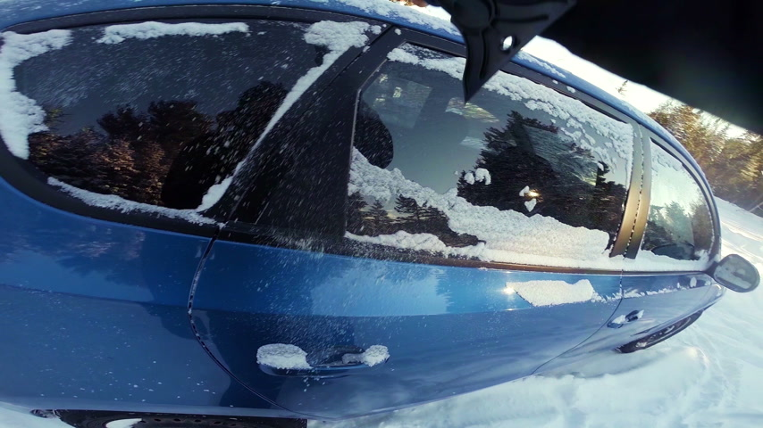 POV of a Man Removing Snow of his Blue Car Stock Footage