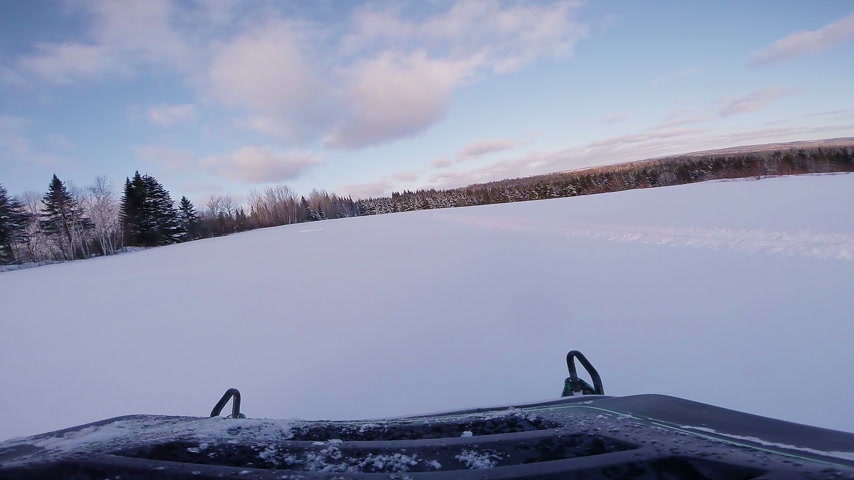 Fast Snowmobile Dash Camera Video during Sunset in Powder Snow. Stock Footage