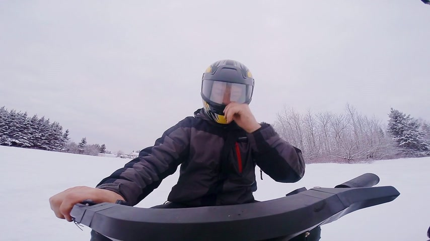Closeup of a Fast Snowmobile Driver in Powder Snow Stock Footage