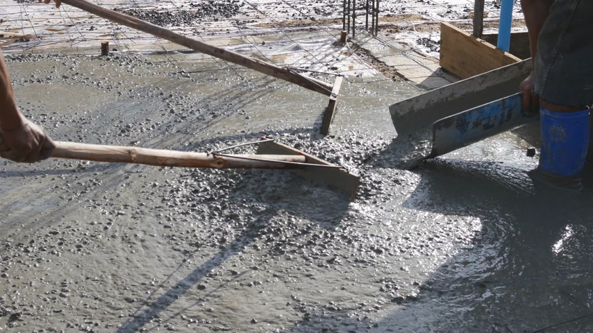 cement floor : Concrete pouring during commercial concreting floors of buildings in construction Stock Footage
