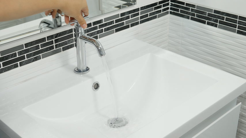 musluk : 4k of Open faucet in the bathroom