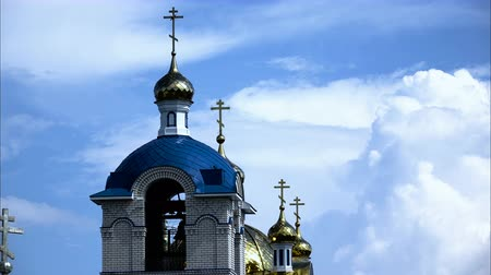 tenger : Church with golden domes on a background of drifting clouds and blue sky. Time lapse. Summer day.