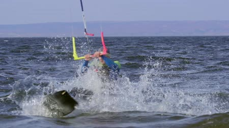 kitesurfer : SLOW MOTION: The kiter takes the jump. Stock Footage