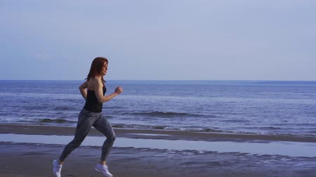 outdoor hobby : SLOW MOTION: Slender middle-aged woman in summer morning. Morning sports run.