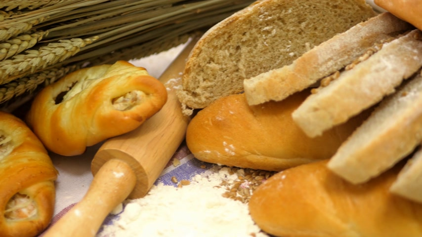 バゲット : Breads and Baked Goods Large Assortment Fresh Baked and Crispy Close Up