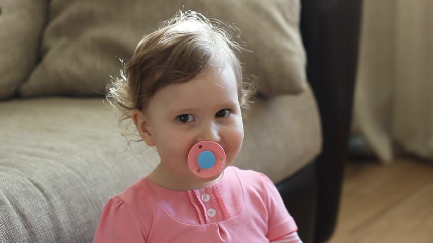 emzik : Funny baby girl with a pacifier