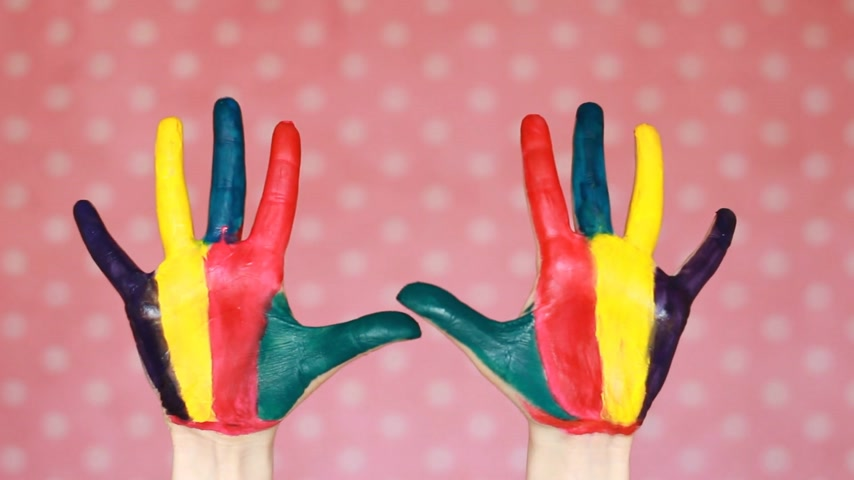гуашь : Colorful painted hands. Creative. Art. Hand in color paint. Dirty palms. Pink background. Стоковые видеозаписи