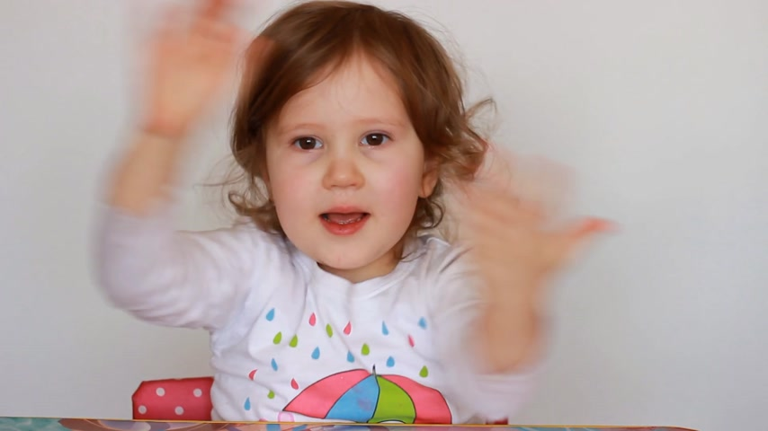 girl claps : Child little girl is smiling, rejoices, have fun and and applauds. Stock Footage
