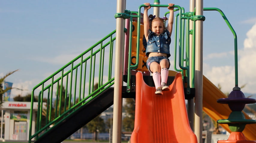 few : The child plays in the playground in different games in the summer. Entertainment for children. Stock Footage