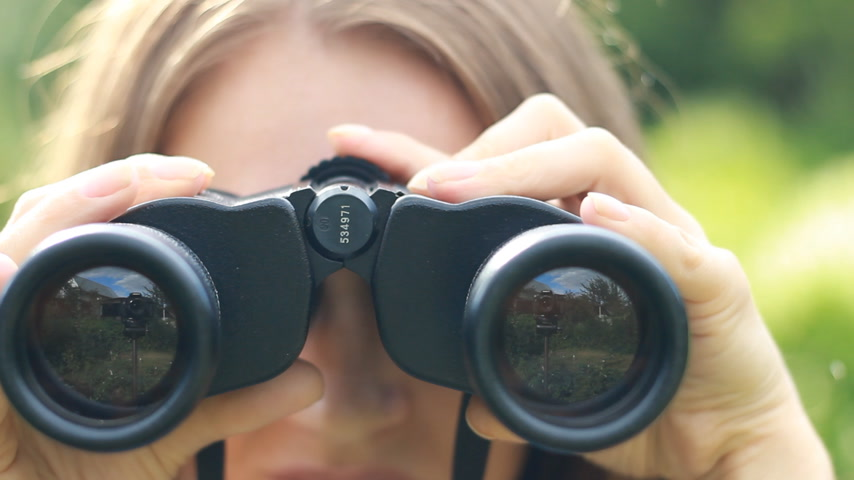 длинные волосы : Woman tourist looking through binoculars closeup. Watch the object, spy.