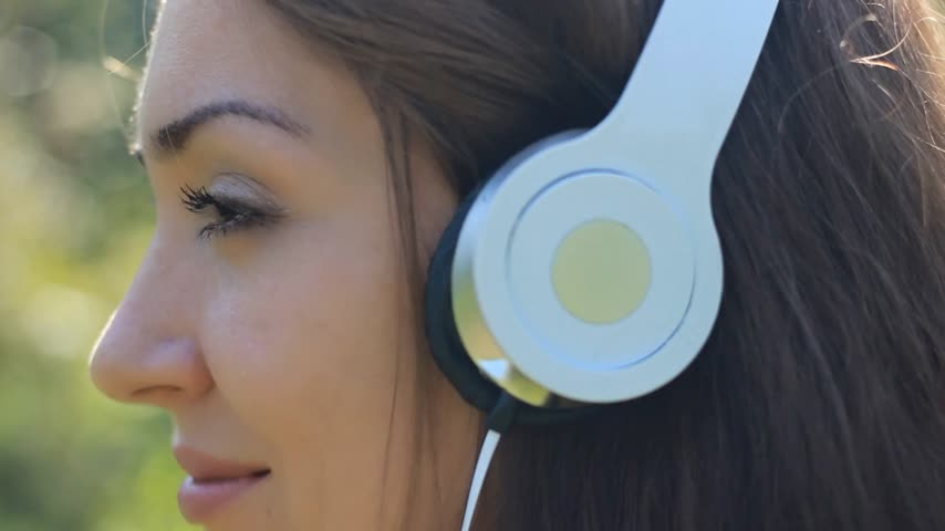 hiphop : Woman closeup in headphones smiling and listening music Stock Footage