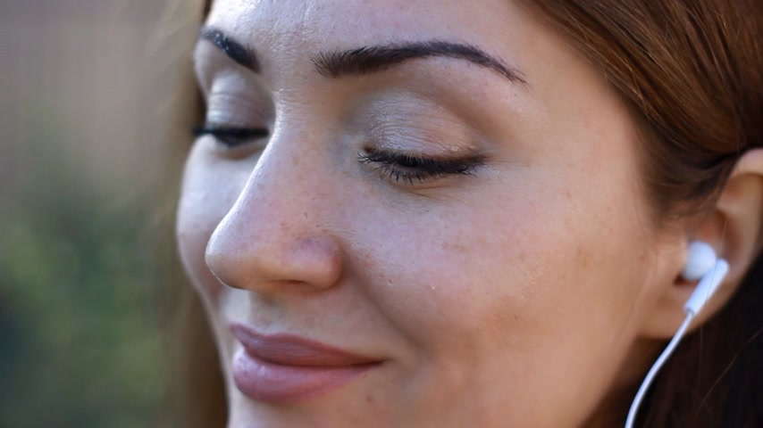 chant : Meditation. Relax. Woman closeup in headphones smiling and listening music.