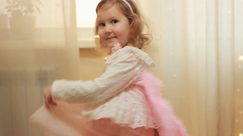 cumplimiento : Baby girl in angel costume or fairy laughing and dancing. Concept of magic and wish fulfillment. Archivo de Video