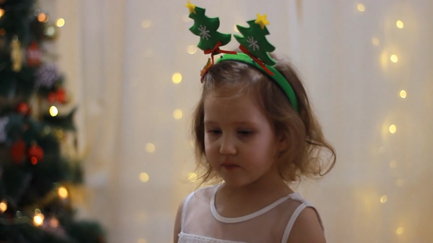 Child girl sings a Christmas song into the microphone