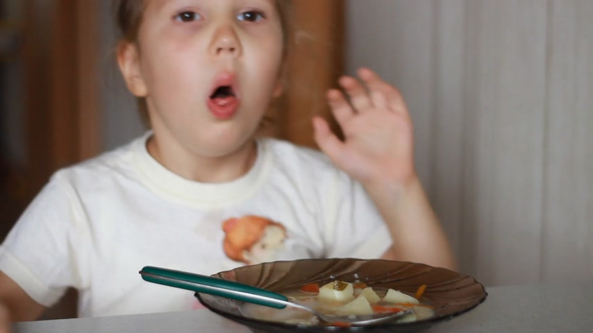 Child girl coughing while eating Stock Footage