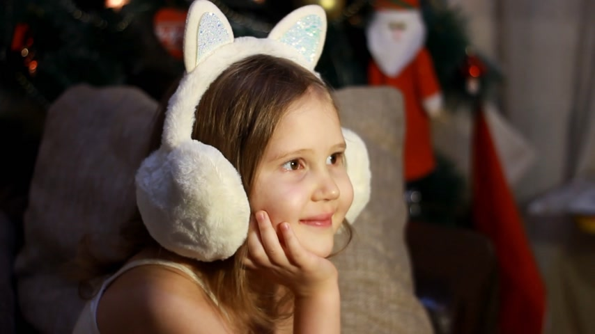 Merry Christmas and Happy new year. Happy child with christmas gift. Wish you merry Christmas. New year kids. Happy cute child in winter headphones present have a Christmas Stock Footage