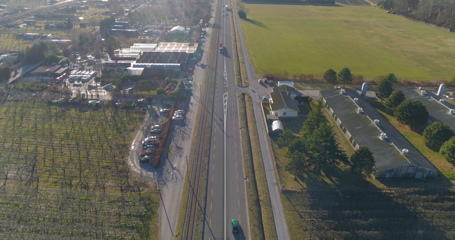 drone shot of road with industrial traffic