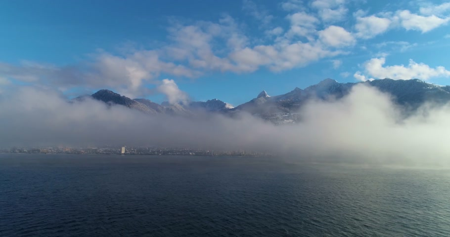 suisse : flying over a lake into the fog Stock Footage