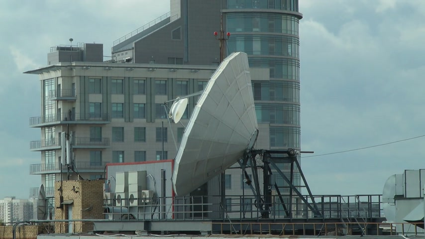 satelite : satellite dish on the roof on the building background