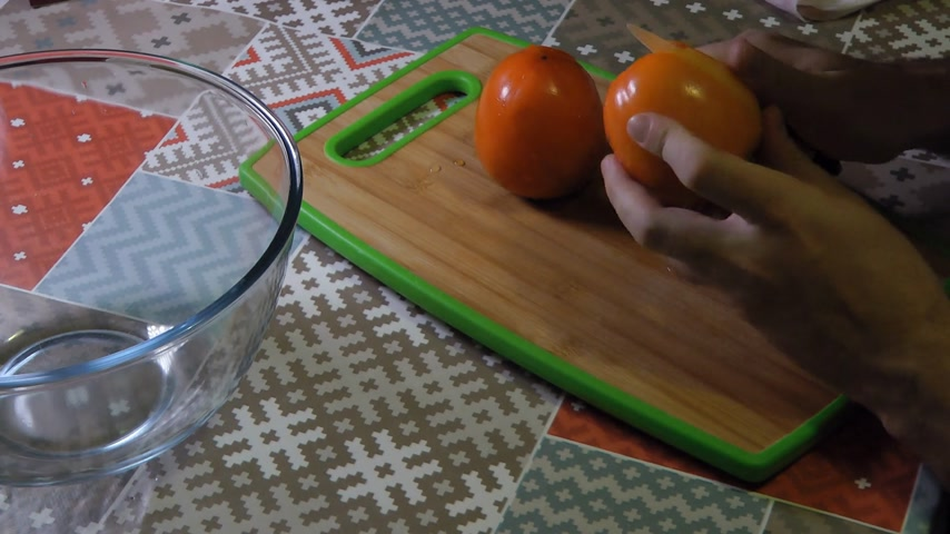 persimmons : Cutting persimmon fast 6x, hands of chef. Stock Footage