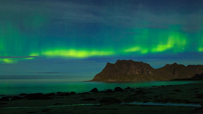 northern nature : Aurora over the sea at Utakleiv beach, Lofoten Islands, Norway