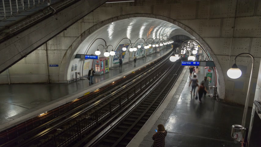 french metro : PARIS, FRANCE - JUNE 14, 207: Arriving and departing trains on metro station timelapse
