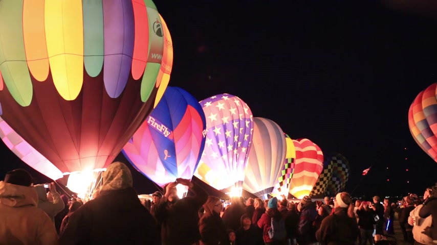 fiesta : Albuquerque, NM - October 5, 2013 - Inflating hot air baloons before sunrise at the annual Albuquerque Balloon Fiesta.