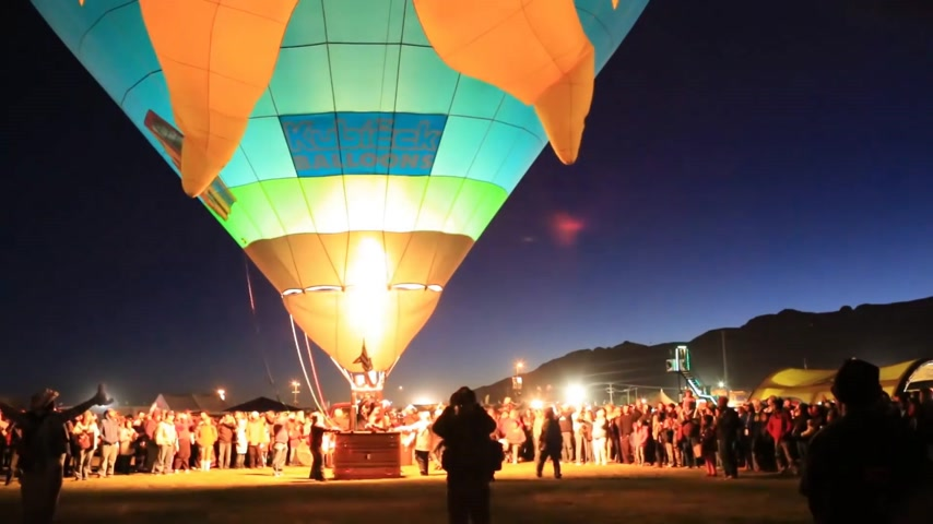 new mexico : Albuquerque, NM - October 5, 2013 - Inflating hot air baloons before sunrise at the annual Albuquerque Balloon Fiesta.