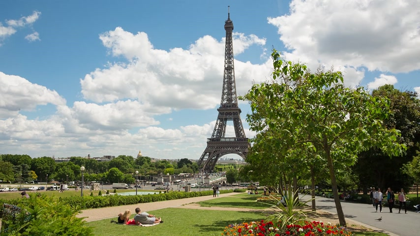 eiffel : PARIS, FRANCE - JUNE 09, 2017: Eiffel Tower video from Trocadero Place. People having rest on a grass.