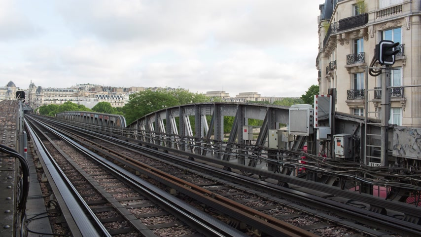 french metro : PARIS FRANCE, JUNE 12, 2017: Metro train timelapse on the pont de Bir Hakeim bridge