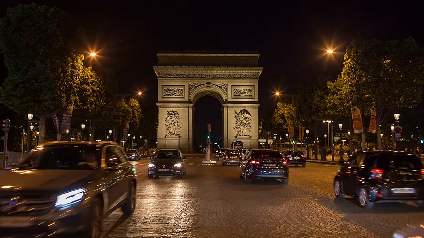 arch of triumph : PARIS, FRANCE - JUNE 12, 2017: A trafic on Chaps Elysees at night with triumphal arch on background
