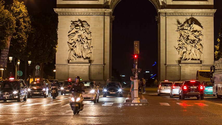 triumphal arch : PARIS, FRANCE - JUNE 12, 2017: A trafic on Chaps Elysees at night with triumphal arch on background