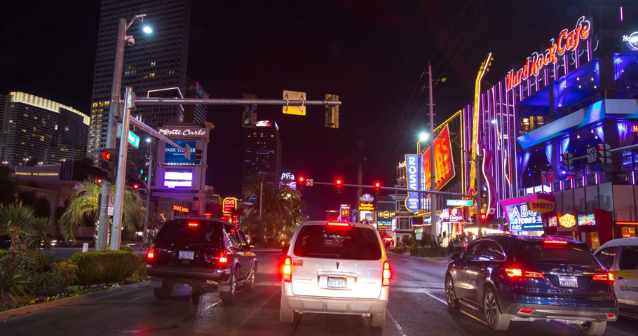 tiras : Las Vegas, USA - January 02, 2018: Hyperlapse traffic view of and neon lights on the streets of Las Vegas at night