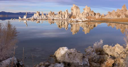 mono lake : Mono lake tufas with reflection in calm water on sunrise with zoom in effect