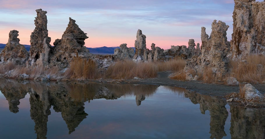 mono lake : Mono lake tufas with reflection in calm water on sunset Stock Footage