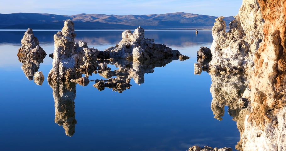 Mono lake tufas with reflection in calm water close-up on sunrise. Stok Video