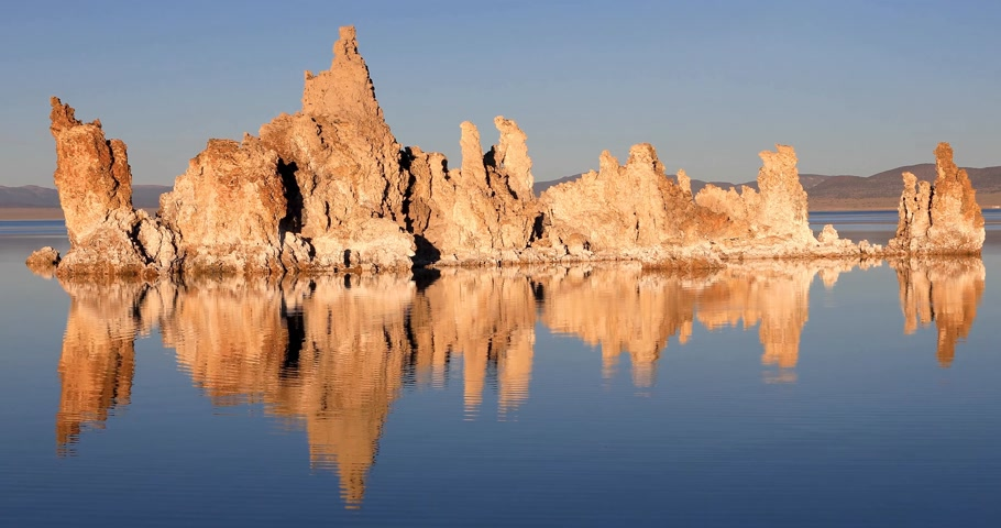 mono lake : Mono lake tufas with reflection in calm water close-up on sunrise. Stock Footage