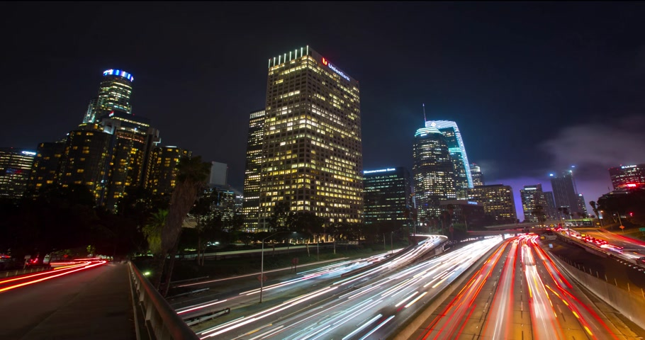 los angeles skyline : LOS ANGELES - January 5, 2018: Downtown skyline highway timelapse at night Stock Footage