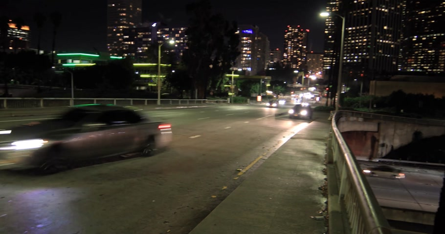 los angeles skyline : LOS ANGELES - January 5, 2018: Downtown skyline and highway 101 at night Stock Footage