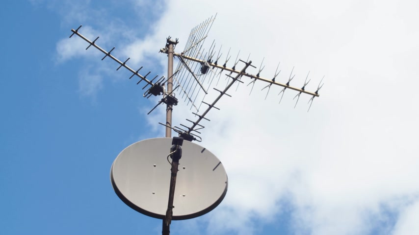 alıcı : TV antenna sky timelapse going from bright to dark stormy clouds.