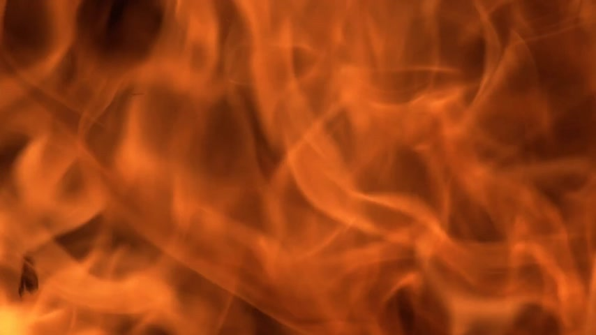 fireside : Fire and flames background on black. Stock Footage